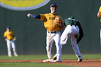 Bailey Peterson (22) of the Michigan State Spartans is out as shortstop Nick Shumski (7) of the Merrimack Warriors turns a double play in a game on Saturday, February 22, 2020, at Fluor Field at the West End in Greenville, South Carolina. Merrimack won, 7-5. (Tom Priddy/Four Seam Images)