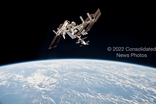 This image of the International Space Station and the docked space shuttle Endeavour, flying at an altitude of approximately 220 miles, was taken by Expedition 27 crew member Paolo Nespoli from the Soyuz TMA-20 following its undocking on May 23, 2011 (USA time). It is the first-ever image of a space shuttle docked to the International Space Station. Onboard the Soyuz were Russian cosmonaut and Expedition 27 commander Dmitry Kondratyev; Nespoli, a European Space Agency astronaut; and NASA astronaut Cady Coleman. Coleman and Nespoli were both flight engineers. The three landed in Kazakhstan later that day, completing 159 days in space..Credit: NASA via CNP