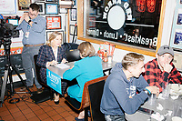 Democratic presidential candidate and Minnesota senator Amy Klobuchar sits at a table for an interview with NECN political reporter Alison King at the Red Arrow Diner during a campaign stop in Manchester, New Hampshire, on Wed., October 16, 2019. The event was part of a 10-county tour of New Hampshire and started the day after the 4th Democratic debate, in which analysts said Klobuchar performed well. <br />  The Red Arrow Diner has been a frequent stop for presidential candidates in New Hampshire for decades.