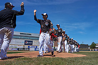 Erie Seawolves, lead by Jason Krizan (7), high five after a game against the Richmond Flying Squirrels on May 20, 2015 at Jerry Uht Park in Erie, Pennsylvania.  Erie defeated Richmond 5-2.  (Mike Janes/Four Seam Images)