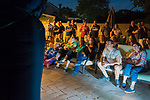 "Merrick, New York, USA. 11th June 2017.  ""American Grit"" TV contestant CHRIS EDOM (at bottom right, wearing white GOT GRIT? T-shirt), 48, sits with his wife, JOAN EDOM, of Merrick, as they host backyard Viewing Party for Season 2 premiere. Edom family and neighbors watched Episode 1 of FOX network reality television series that Sunday night on a big screen (at left) outdoors. Edom was last contestant picked for a team."