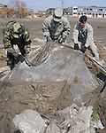 Airmen uncover plastic sheets April 1, 2011, at a strawberry farm in Hachinohe, Japan. (Photo by USAF/AFLO) [0006]..
