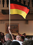 09 June 2006: A German fan in a crowded bar in Munich waives a flag during the game. Germany played Costa Rica at the Allianz Arena in Munich, Germany in the opening match, a Group A first round game, of the 2006 FIFA World Cup.