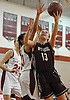 Gabrielle Zaffiro #13 of North Shore, right, drives to the hoop during a varsity girls' basketball game against host Glen Cove High School on Friday, Dec. 18, 2015. She scored a game high 36 points, including 16 in the third quarter, to lead North Shore to a 64-53 win.