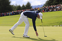 Matthew Fitzpatrick (ENG) sinks his putt on the 18th green during Sunday's Final Round of the 2017 Omega European Masters held at Golf Club Crans-Sur-Sierre, Crans Montana, Switzerland. 10th September 2017.<br /> Picture: Eoin Clarke | Golffile<br /> <br /> <br /> All photos usage must carry mandatory copyright credit (&copy; Golffile | Eoin Clarke)