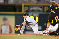 Jupiter Hammerheads second baseman Terrence Dayleg (13) waits for a throw as Jonathan Schwind (13) slides in during a game against the Bradenton Marauders on April 19, 2014 at McKechnie Field in Bradenton, Florida.  Bradenton defeated Jupiter 4-0.  (Mike Janes/Four Seam Images)