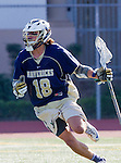 Tustin, CA 04/23/16 - Garrett DeLeon {La Costa Canyon #18) in action during the non-conference CIF varsity lacrosse game between La Costa Canyon and Foothill at Tustin Union High School.  Foothill defeated La Costa Canyon 10-9 in sudden death overtime.