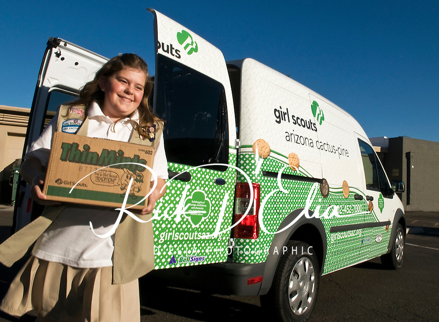 Girl Scouts from the Arizona Cactus-Pine Council unload a Ford Transit Connect van donated by Sanderson Ford in Phoenix to assist the troop with their biggest fundraiser, delivering cookies.