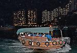 A junk ferries people in Aberdeen harbour, Hong Kong Island