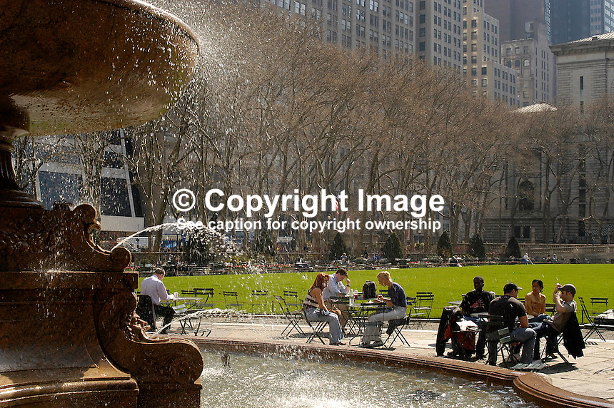 New Yorkers enjoy the spring sunshine in Bryant Park, Manhatten, New York, USA. Ref: 200304160005...Copyright Image from Victor Patterson, 54 Dorchester Park, Belfast, UK, BT9 6RJ..Tel: +44 28 9066 1296.Mob: +44 7802 353836.Voicemail +44 20 8816 7153.Skype: victorpattersonbelfast.Email: victorpatterson@mac.com.Email: victorpatterson@ireland.com (back-up)..IMPORTANT: If you wish to use this image or any other of my images please go to www.victorpatterson.com and click on the Terms & Conditions. Then contact me by email or phone with the reference number(s) of the image(s) concerned.