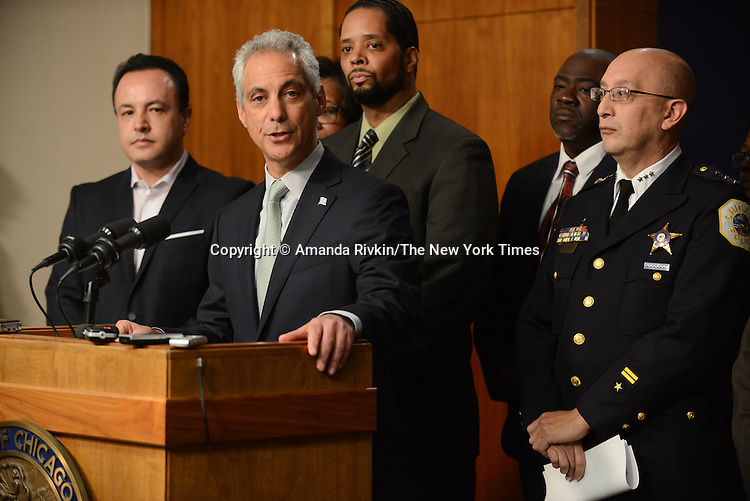Chicago Mayor Rahm Emanuel during a press conference at Chicago City Hall flanked by Interim Chicago Police Superintendent John Escalante (far right) announcing more Tasers for Chicago police officers and training following a deadly shooting involving Chicago police over the weekend while Mayor Emanuel was on vacation in Cuba in Chicago, Illinois on December 30, 2015.  Over the weekend, Chicago police shot and killed 55 year old Bettie Jones and 19 year old Quintonio LeGrier while responding to a call over a domestic incident.