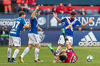 SADAR, PAMPLONA, SPAIN: The Football League, CA Osasuna vs Tenerife; Rober Ibañez falls to several defenders of Tenerife on day 33 of Liga 123. April 1, 2018