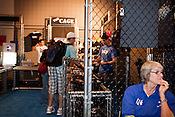 August 29, 2010. Raleigh, North Carolina. . A guard watches over the mechandise cage.. Major League Gaming (MLG), the league for professional videogame players, held their 50th Pro Circuit competition at the Raleigh Convention Center, with gamers from all over the country coming to for 3 days of competition in Halo 3, Tekken 6, Super Smash Bros. Brawl, Starcraft 2 and World of Warcraft.