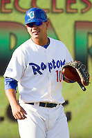Ogden Raptors catcher Jose Capellan (10) warms up in the outfield prior to the game against the Orem Owlz at Lindquist Field on July 28, 2012 in Ogden, Utah.  The Raptors defeated the Owlz 8-7.   (Brian Westerholt/Four Seam Images)