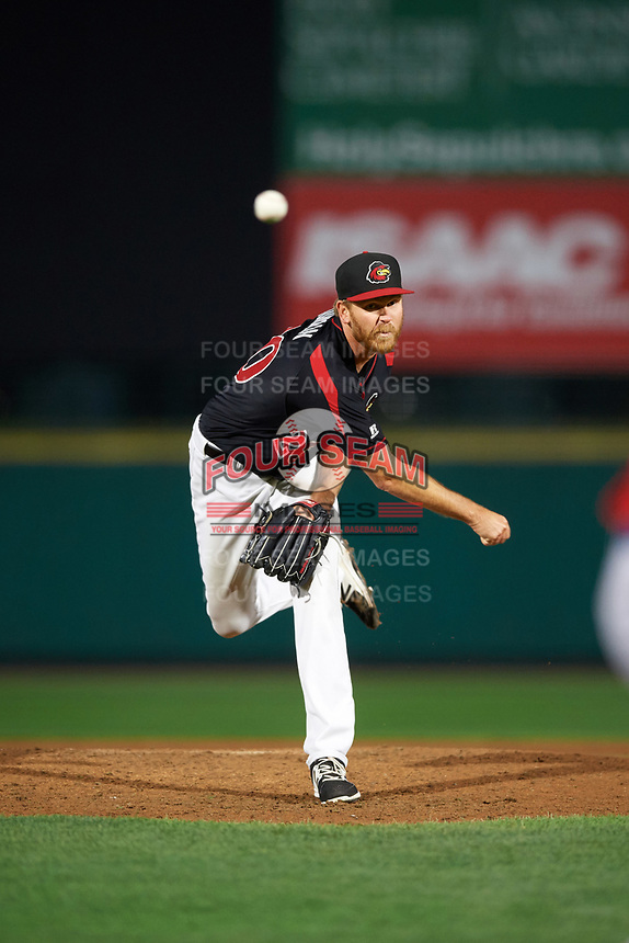 Rochester Red Wings relief pitcher Michael Tonkin (20) follows through on a pitch during a game against the Buffalo Bisons on August 25, 2017 at Frontier Field in Rochester, New York.  Buffalo defeated Rochester 2-1 in eleven innings.  (Mike Janes/Four Seam Images)