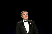 Washington, D.C. - April 21, 2007 - United States President George W. Bush arrives at the White House Correspondents Association Dinner April 21, 2007 in Washington, DC.  Comedian Rich Little hosted and provided entertainment for Bush, White House reporters, their guests and celebrities.  .Credit: Brendan Smialowski - Pool via CNP