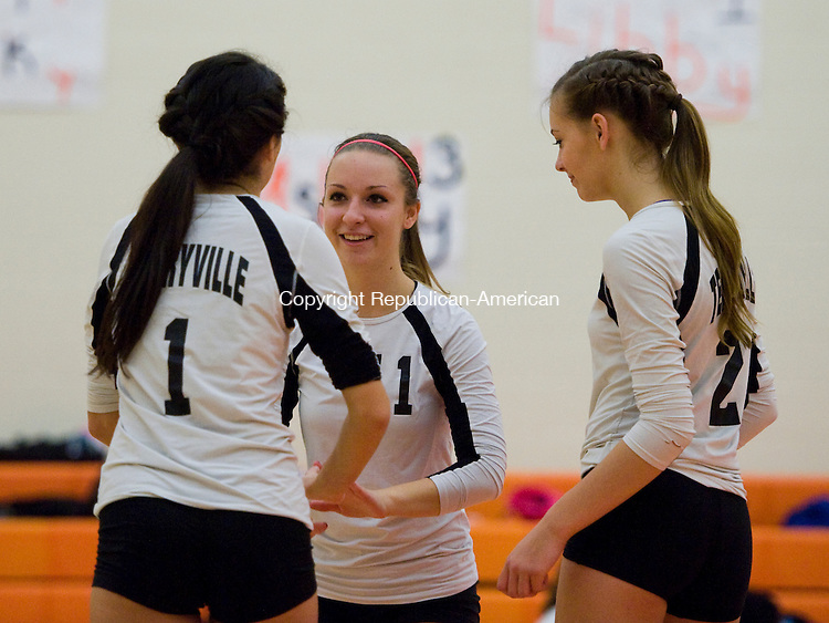 TERRYVILLE, CT-16 October 2014-101614EC02--   Terryville's (1) Libby Rrahimi, (11) Brianna Lane and (2) Leah Switser celebrate after scoring a point against Wolcott Tech at Terryville High School Thursday night. Erin Covey Republican-American