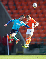 Blackpool's Ollie Turton in action with Fleetwood Town's Conor McAleny<br /> <br /> Photographer Mick Walker/CameraSport<br /> <br /> The EFL Sky Bet League One - Blackpool v Fleetwood Town - Saturday 14th April 2018 - Bloomfield Road - Blackpool<br /> <br /> World Copyright &copy; 2018 CameraSport. All rights reserved. 43 Linden Ave. Countesthorpe. Leicester. England. LE8 5PG - Tel: +44 (0) 116 277 4147 - admin@camerasport.com - www.camerasport.com