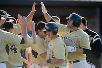 Weldon Woodall #25 of the Wake Forest Demon Deacons high fives his teammates after hitting a home run versus the Duke Blue Devils at Jack Coombs Field March 29, 2009 in Durham, North Carolina. (Photo by Brian Westerholt / Four Seam Images)