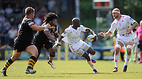 Djibril Camara of Stade Francais looks to offload to Scott Lavalla of Stade Francais as he is tackled by Ashley Johnson of London Wasps during the first leg of the European Rugby Champions Cup play-off match between London Wasps and Stade Francais at Adams Park on Sunday 18th May 2014 (Photo by Rob Munro)