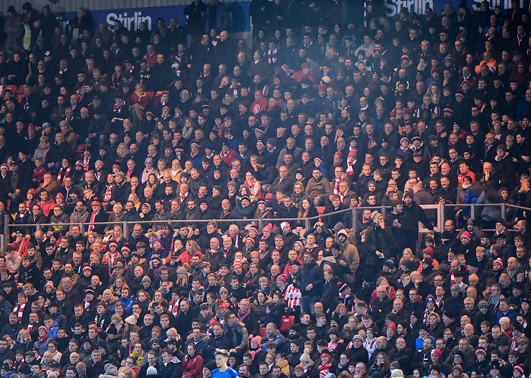 Lincoln City fans watch their team in action<br /> <br /> Photographer Andrew Vaughan/CameraSport<br /> <br /> The EFL Checkatrade Trophy Fourth Round - Lincoln City v Peterborough United - Tuesday 23rd January 2018 - Sincil Bank - Lincoln<br />  <br /> World Copyright &copy; 2018 CameraSport. All rights reserved. 43 Linden Ave. Countesthorpe. Leicester. England. LE8 5PG - Tel: +44 (0) 116 277 4147 - admin@camerasport.com - www.camerasport.com