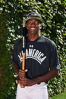 Outfielder Marcus Wilson (8) of Junipero Serra High School in Los Angeles, California poses for a photo before the Under Armour All-American Game on August 24, 2013 at Wrigley Field in Chicago, Illinois.  (Mike Janes/Four Seam Images)