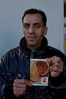 Roma 7 Febbraio  2014<br /> Il Centro di identificazione ed espulsione (CIE), per immigrati di Ponte Galeria a Roma. Migrante mostra la foto del figlio<br />   Center for Identification and Expulsion (CIE) for immigrants from Ponte Galeria in Rome. Migrant  show the photo of his son