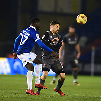 Lincoln City's Tom Pett vies for possession with Oldham Athletic's Christopher Missilou<br /> <br /> Photographer Andrew Vaughan/CameraSport<br /> <br /> The EFL Sky Bet League Two - Oldham Athletic v Lincoln City - Tuesday 27th November 2018 - Boundary Park - Oldham<br /> <br /> World Copyright © 2018 CameraSport. All rights reserved. 43 Linden Ave. Countesthorpe. Leicester. England. LE8 5PG - Tel: +44 (0) 116 277 4147 - admin@camerasport.com - www.camerasport.com