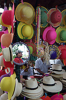 Straw hats for sale in the Sunday market in the main square of Merida, Yucatan, Mexico...