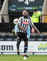 Paul Hayes of Wycombe Wanderers clears from Stanley Aborah of Notts County during the Sky Bet League 2 match between Notts County and Wycombe Wanderers at Meadow Lane, Nottingham, England on 28 March 2016. Photo by Andy Rowland.