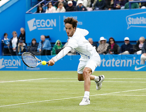 22.06.2013. Eastbourne, England.  Feliciano Lopez(ESP) defeats Giles Simon(FRA) in the mens Singles Finals by a score 7-6, 6-7, 6-0 during the AEGON International tournament at Devonshire Park
