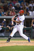 Alexander Malleta Kerr (55) of the Cuban National Team follows through on his swing against the US Collegiate National Team at BB&T BallPark on July 4, 2015 in Charlotte, North Carolina.  The United State Collegiate National Team defeated the Cuban National Team 11-1.  (Brian Westerholt/Four Seam Images)