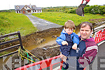 William Dennehy outside his house with his son Liam after their footpath was washed away in a flash flood in Duagh on Tuesday evening.