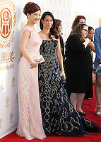 HOLLYWOOD, LOS ANGELES, CA, USA - JUNE 01: Olivia Xu, Lucy Liu at the 12th Annual Huading Film Awards held at the Montalban Theatre on June 1, 2014 in Hollywood, Los Angeles, California, United States. (Photo by Xavier Collin/Celebrity Monitor)