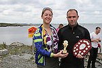 """Sue McKinney presents Mark Watters who came first at the Clogherhead """"Round the Head Swim""""....(Photo credit should read Jenny Matthews/NEWSFILE)..."""