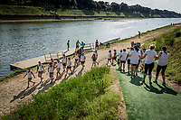 Træning på floden Arno forud for konkurrencen. IBCPC Dragon Boat Festival i Firenze er en dragebådsfestival for brystkraftramte kvinder. Copenhagen Dragonboat Team deltager med godt 20 kvinder i alderen fra 25 til 62.<br /> <br /> Foto: Jens Panduro<br /> <br /> The IBCPC Dragon Boat Festival is held every four years under the auspices of the International Breast Cancer Paddler's Commission. The Festival is an international non-competitive participatory event targeting Breast Cancer Survivors teams who engage in Dragon Boat activities as post-operative rehabilitation. Born from the idea of a Canadian sports medicine physician, Doctor Don McKenzie about twenty years ago, Dragon Boat paddling has become a rehabilitation therapy for tens of thousands of men and women worldwide, who have undergone surgery.<br /> For the first time since its institution in 2005, the IBCPC FESTIVAL will be held in Europe – in Italy!! The Florence 2018 Festival will involve 129 teams from 17 countries , and for the very first time ALL the continents are represented.<br /> Organised and promoted by FIRENZE IN ROSA Onlus as the official Organising Committee, the Florence Festival will be a sporting event but above all a social occasion in which Florence will welcome from 4,000 to 5,000 people from all over the world. The participants are mainly women between the ages of 20 and 80, who will meet to take part in the exciting Dragon Boat races, paddling together on the Arno. They will also be accompanied by their friends and family, their faithful and enthusiastic supporters.