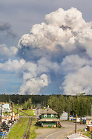 Forest fire rages near the village of Nenana, Alaska during June of 2006. Tanana river in the foreground.