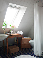 The table in this attic bathroom comes from an old seaman's hostel in Helsingborg