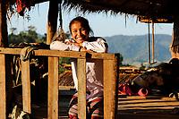 LAO PDR, province Oudomxay , village Houyta, ethnic group Khmu, smiling Khmu girl Vanna / LAOS Provinz Oudomxay, Dorf Houyta , Ethnie Khmu , Portraet des Maedchen Vanna  - NUR FÜR REDAKTIONELLE NUTZUNG, Kein PR !