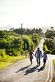 MAURITIUS, a family nears the top of a long road to have a look into Troux aux Cerfs crater, the town of Curepipe