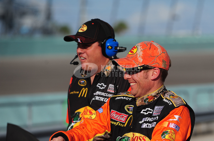 Nov. 19, 2010; Homestead, FL, USA; NASCAR Sprint Cup Series driver Jamie McMurray (right) with crew chief Kevin Manion during qualifying for the Ford 400 at Homestead Miami Speedway. Mandatory Credit: Mark J. Rebilas-