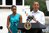 United States President Barack Obama with First Lady Michelle speaks at a Coast Guard base in Panama City, Florida USA on Saturday, 14 August  2010.  The First Family is visiting the area to help promote tourism and check up on clean up efforts from the aftermath of the Deepwater Horizon Oil spill. .Credit: Dan Anderson / Pool via CNP
