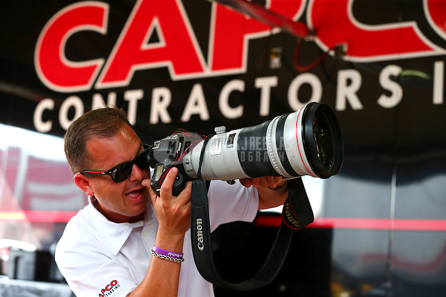 May 30, 2014; Englishtown, NJ, USA; NHRA top fuel driver Steve Torrence takes pictures with a camera during qualifying for the Summernationals at Raceway Park. Mandatory Credit: Mark J. Rebilas-