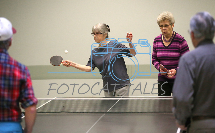 From left, Bob Parks, Shirley Ling, Barbel Naeslund and Bill Kenson practice for the Reno Tahoe Senior Games table tennis competition at the Carson City Senior Citizen Center in Carson City, Nev., on Friday, Jan. 29, 2016. <br /> Photo by Cathleen Allison