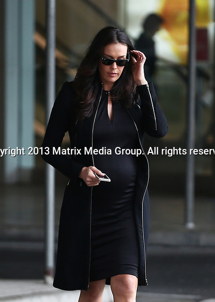 28 FEBRUARY 2014 SYDNEY AUSTRALIA<br /> <br /> EXCLUSIVE <br /> <br /> Megan Gale pictured on arrival into Sydney ahead of Charlotte Dawson's memorial gathering. Megan travelled in her comfy maternity clothes and after a quick change into a belly hugging yet elegant black dress she was on her way to Charlottes memorial.<br /> <br /> *No internet without clearance*<br /> MUST CALL PRIOR TO USE .<br /> +61 2 9211-1088<br /> Matrix Media Group<br /> Note: All editorial images subject to the following: For editorial use only. Additional clearance required for commercial, wireless, internet or promotional use.Images may not be altered or modified. Matrix Media Group makes no representations or warranties regarding names, trademarks or logos appearing in the images.