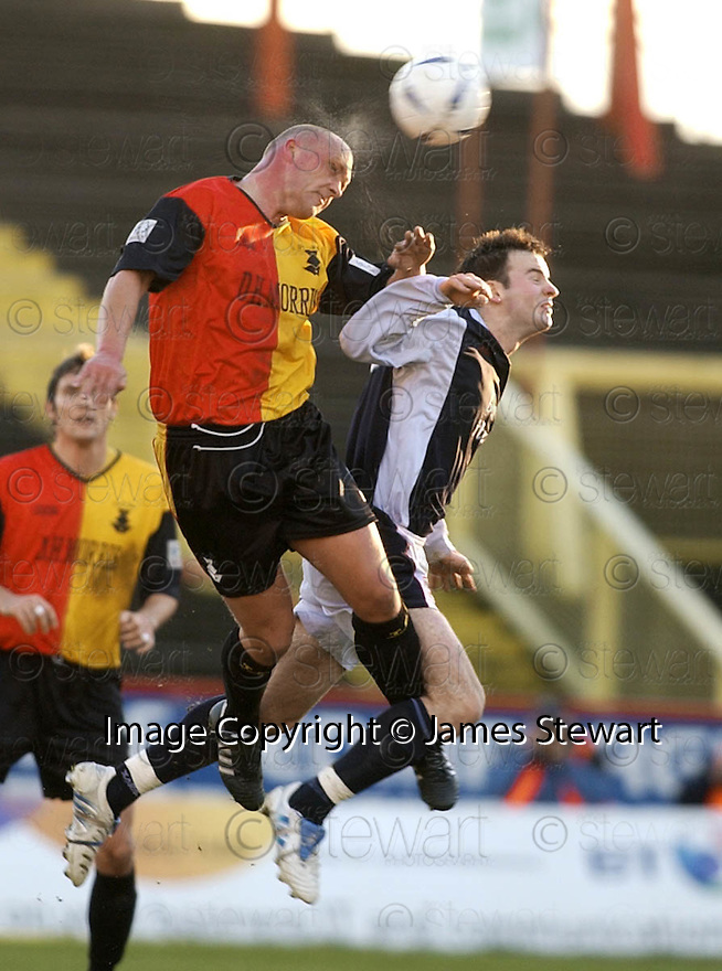 29/01/2005  Copyright Pic : James Stewart.File Name : jspa12_partick v raith.STEPHEN FULTON HEADS CLEAR FROM CONALL MURTAGH.....Payments to :.James Stewart Photo Agency 19 Carronlea Drive, Falkirk. FK2 8DN      Vat Reg No. 607 6932 25.Office     : +44 (0)1324 570906     .Mobile   : +44 (0)7721 416997.Fax         : +44 (0)1324 570906.E-mail  :  jim@jspa.co.uk.If you require further information then contact Jim Stewart on any of the numbers above.........A