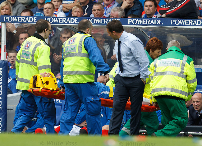 Murray Davidson stretchered off the park as St Johnstone manager Derek McInnes cheack on him
