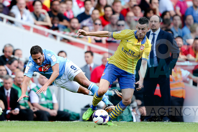 Napoli's Gonzalo Higuaín is tackled hard by Laurent Koscielny of Arsenal - Arsenal v Napoli - Emirates Cup - Day 1 - Emirates Stadium - London - 3rd August 2013 - Pic Charlie Forgham-Bailey/Sportimage