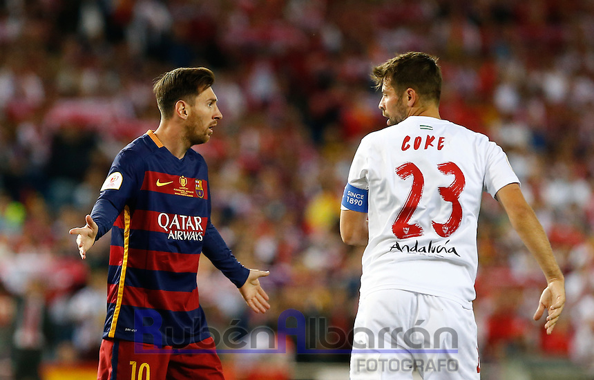 FC Barcelona´s Argentinean forward Lionel Messi and Sevilla´s midfielder Coke during the Final of Copa del Rey match between FC Barcelona and SevillaFC at the Vicente Calderon Stadium in Madrid, Sunday, May 22, 2016.