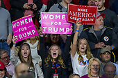 Supporters hold campaign signs during a Make America Great Again campaign rally at Atlantic Aviation in Moon Township, Pennsylvania on March 10th, 2018. Credit: Alex Edelman / CNP